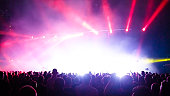 Stage lights and crowd of people in rock concert