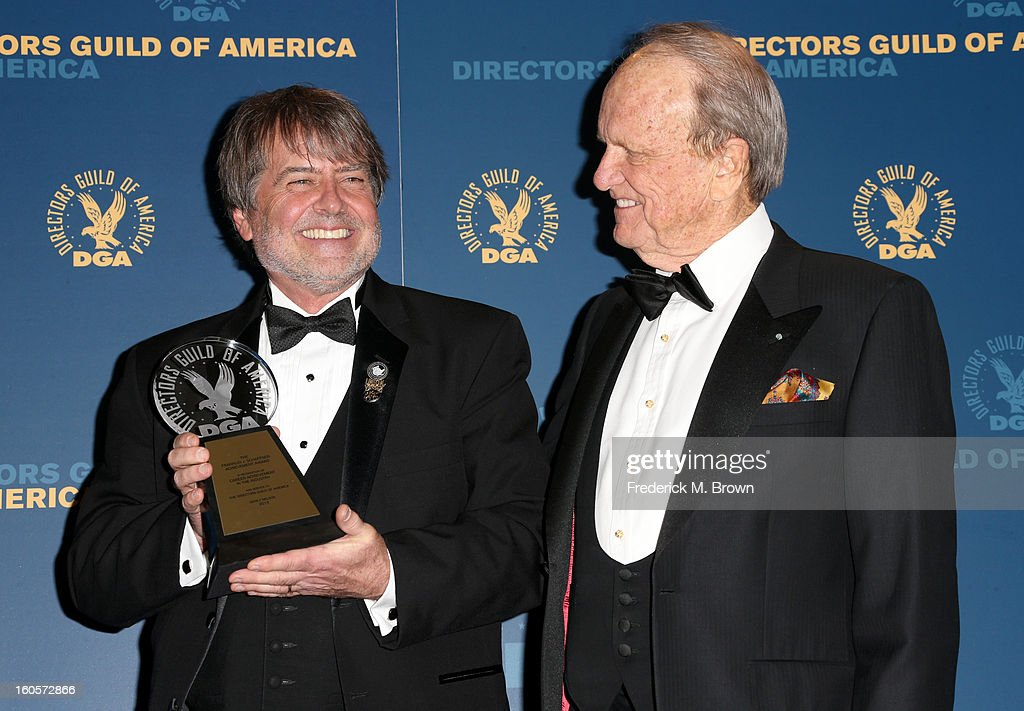 Stage Manager Dency Nelson (L), winner of the Franklin J. Schaffner Achievement Award, and presenter George Stevens Jr. pose in the press room during the 65th Annual Directors Guild Of America Awards at Ray Dolby Ballroom at Hollywood & Highland on February 2, 2013 in Los Angeles, California.