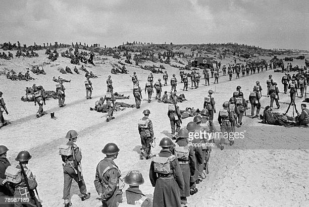 Stage Screen Camber Sands England The beaches packed with 'soldiers' during Ealing Studios film reconstruction of the evacution of the Dunkirk...