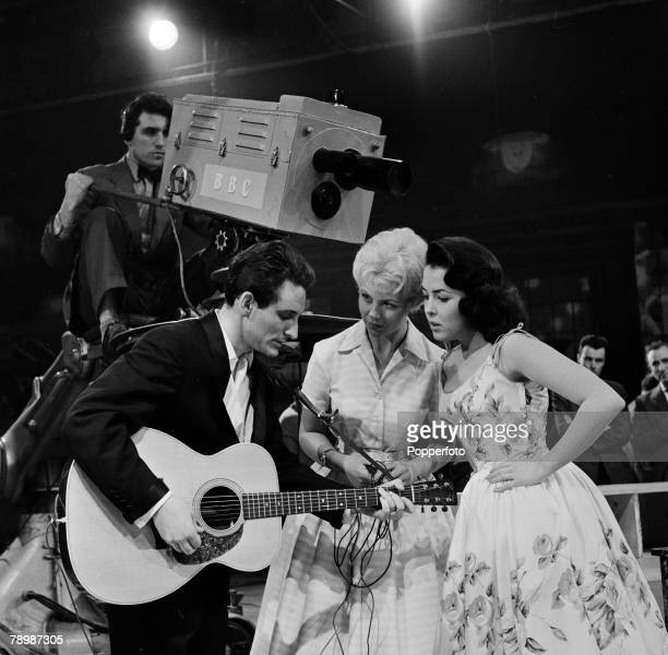 Stage Screen London England During the making of 'Six Five Special' at Twickenham studio's Singer Lonnie Donegan on the set talking with two young...