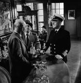 Stage Screen London England The making of the film 'Barnacle Bill' at Ealing studio's Actor Alec Guiness as a naval Captain standing at the bar