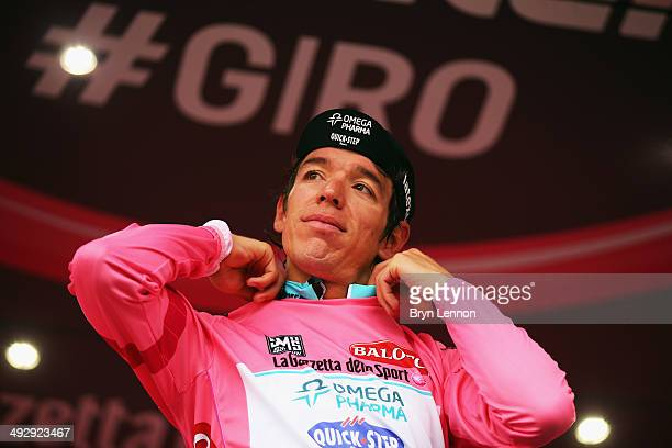 Stage winner and new race leader and wearer of the Maglia Rosa Rigoberto Uran of Colombia and Omega PharmaQuickstep celebrates on the podium after...