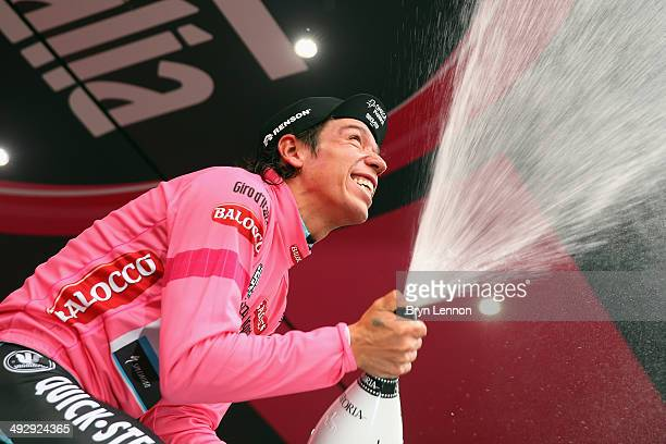 Stage winner and new race leader and wearer of the Maglia Rosa Rigoberto Uran of Colombia and Omega PharmaQuickstep celebrates and sprays prosecco on...