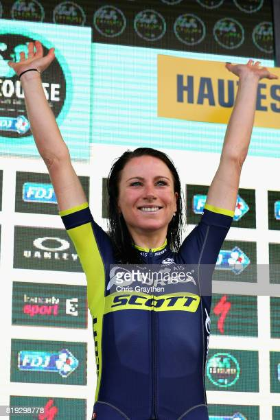 Stage winner Annemiek Van Vleuten of Netherlands riding for Team Orica Scott celebrates on the podium after the first stage of the 4th La Course by...