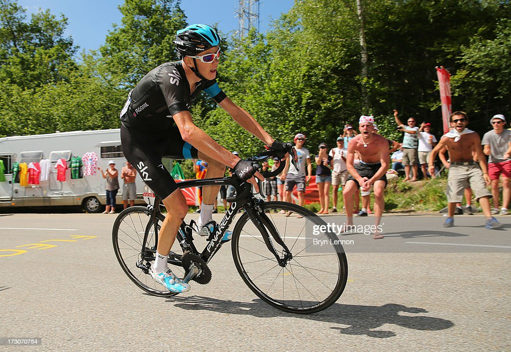 Stage winner <a gi-track='captionPersonalityLinkClicked' href=/galleries/search?phrase=Chris+Froome&family=editorial&specificpeople=5428054 ng-click='$event.stopPropagation()'>Chris Froome</a> of Great Britain and Team Sky Procycling is cheered on by the crowd during stage eight of the 2013 Tour de France, a 195KM road stage from Castres to Ax 3 Domaines, on July 6, 2013 in Ax 3 Domaines, France.