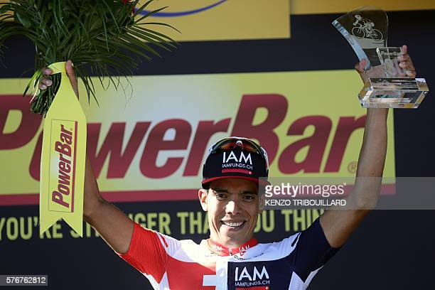 Stage winner Colombia's Jarlinson Pantano celebrates on the podium after winning the 160 km fifteenth stage of the 103rd edition of the Tour de...