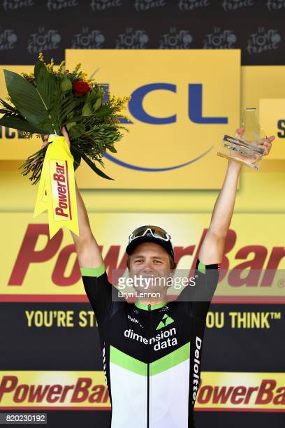 Stage winner Edvald Boasson Hagen of Norway riding for Team Dimension Data celebrates on the podium after stage nineteen of the 2017 Tour de France a...