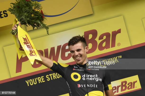 Stage winner France's Lilian Calmejane celebrates on the podium after winning the 1875 km eighth stage of the 104th edition of the Tour de France...