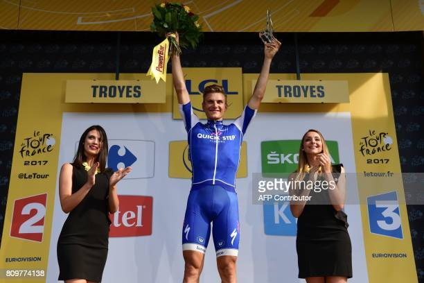 Stage winner Germany's Marcel Kittel celebrates on the podium after winning the 216 km sixth stage of the 104th edition of the Tour de France cycling...