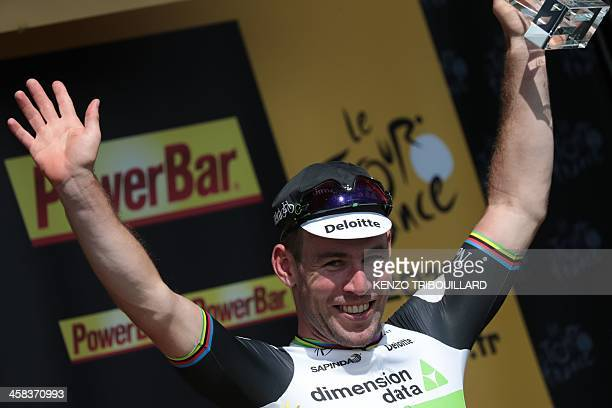 Stage winner Great Britain's Mark Cavendish celebrates on the podium after winning the 188 km first stage of the 103rd edition of the Tour de France...