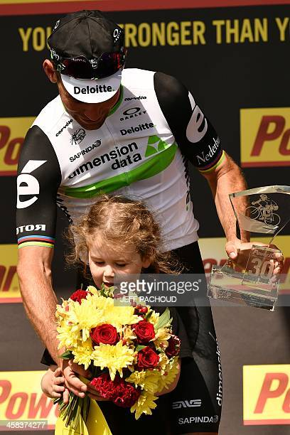 Stage winner Great Britain's Mark Cavendish celebrates with his daughter on the podium at the end of the 188 km first stage of the 103rd edition of...