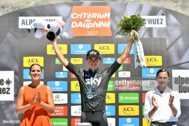 Stage winner Great Britain's Peter Kennaugh celebrates on the podium after winning the 168 km seventh stage of the 69th edition of the Criterium du...