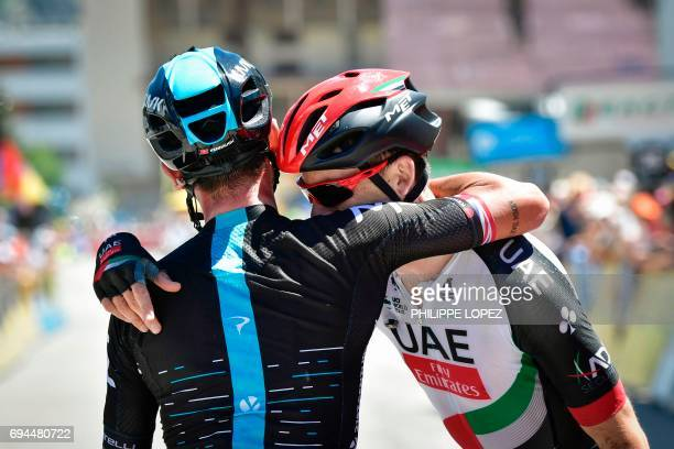 Stage winner Great Britain's Peter Kennaugh is congratulated by secondplaced Great Britain's Ben Swift at the end of the 168 km seventh stage of the...