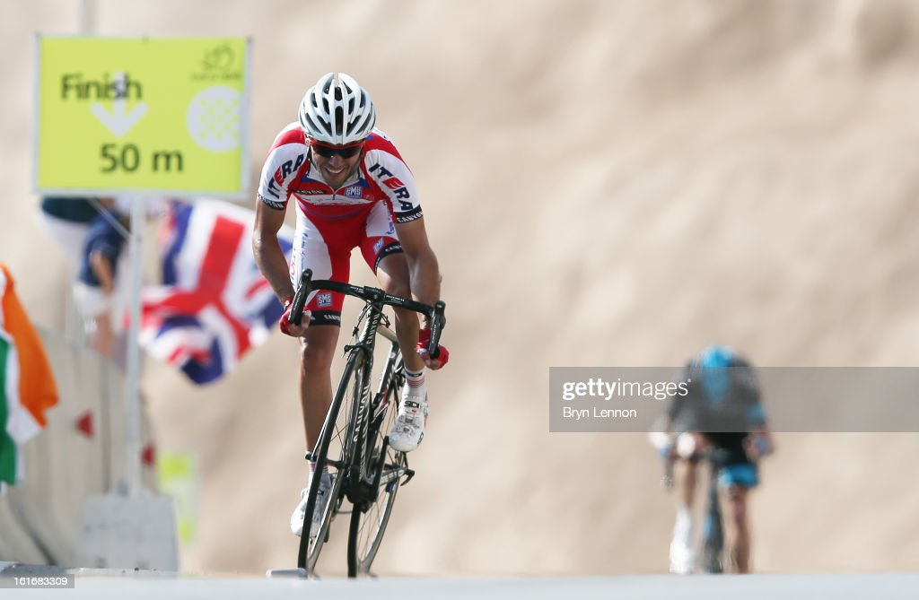 Stage winner Joaquim Rodriguez of Spain and Katusha climbs to victory on stage four of the 2013 Tour of Oman from Al Saltiyah in Samail to Jabal Al Akhdhar (Green Mountain) on February 14, 2013 in Jabal Al Akhdhar, Oman.