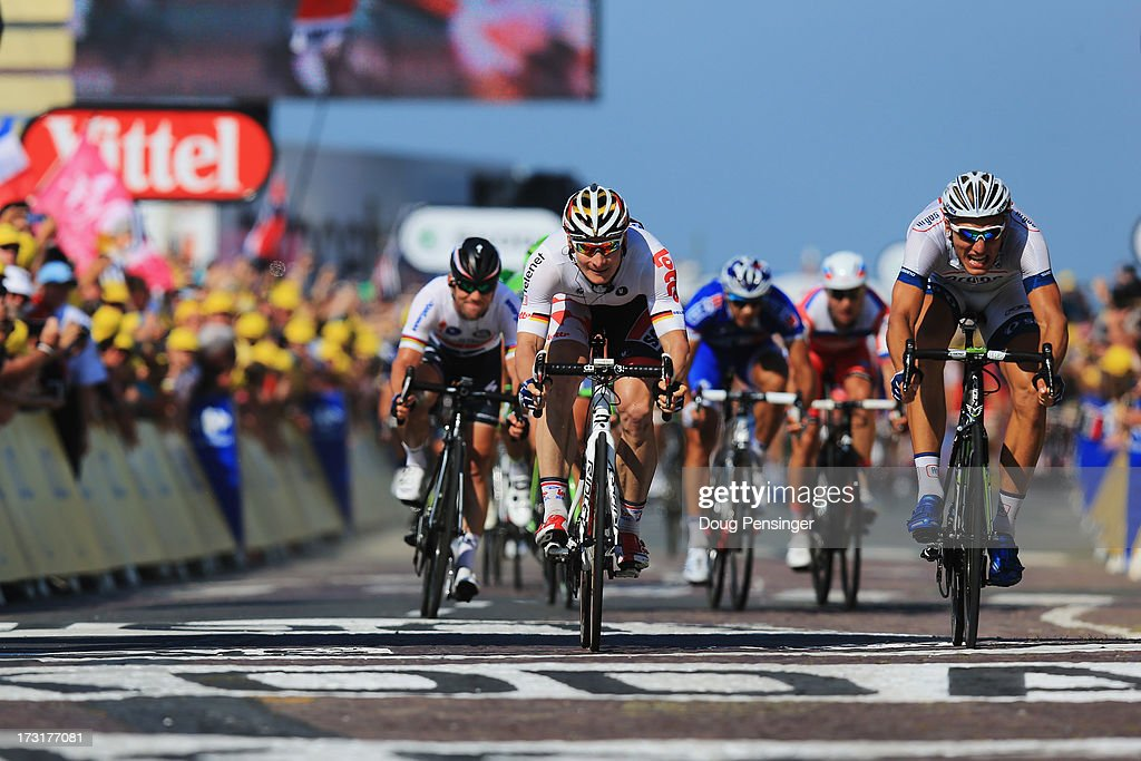Stage winner Marcel Kittel (R) of Germany and Team Argos-Shimano beats second placed Andre Greipel (C) of Germany and Team Lotto Belisol and third placed Mark Cavendish (L) of Great Britain and Omega Pharma-Quick Step to the line during stage ten of the 2013 Tour de France, a 197KM road stage from St-Gildas-des-Bois to Saint Malo, on July 9, 2013 in St Malo, France.