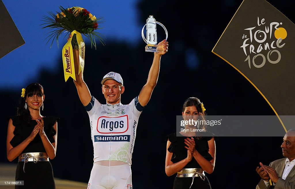 Stage Winner <a gi-track='captionPersonalityLinkClicked' href=/galleries/search?phrase=Marcel+Kittel&family=editorial&specificpeople=4520423 ng-click='$event.stopPropagation()'>Marcel Kittel</a> of Germany and Team Argos-Shimano celebrates on the podium after the twenty first and final stage of the 2013 Tour de France, a processional 133.5KM road stage ending in an evening race around the Champs-Elysees, on July 21, 2013 in Paris, France.
