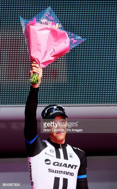 Stage winner Marcel Kittel of GiantShimano celebrates during the presentations after Stage two of the 2014 Giro D'Italia in Belfast