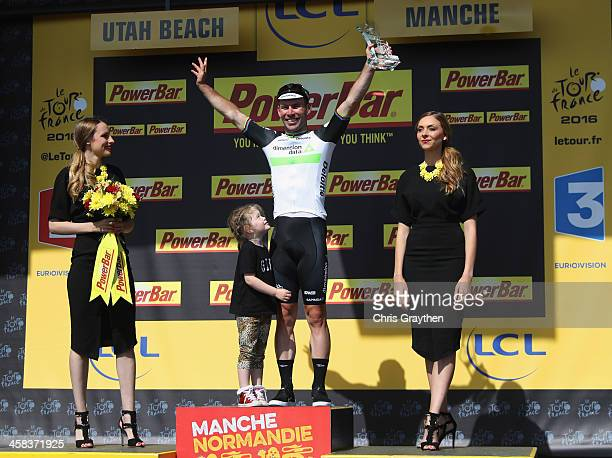 Stage winner Mark Cavendish of Great Britain and Team Dimension Data celebrates on the podum with daughter Deliah after victory during Stage One of...