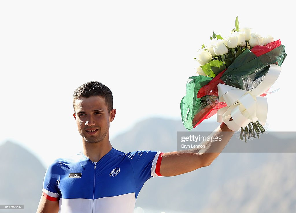 Stage winner Nacer Bouhanni of France and FDJ stands on the podium after stage six of the 2013 Tour of Oman from Hawit Nagam Park to the Matrah Corniche on February 16, 2013 in Matrah, Oman.