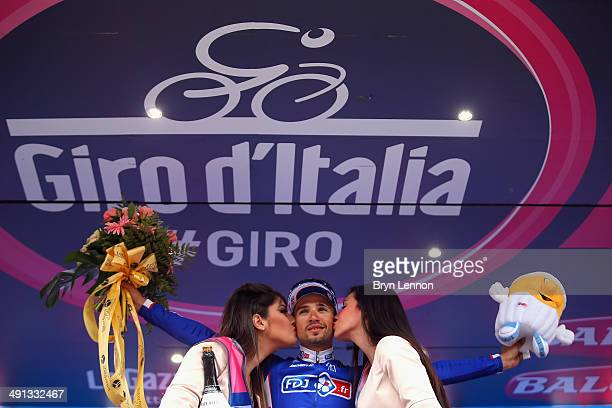 Stage winner Nacer Bouhanni of France and FDJfr celebrates on the podium after the seventh stage of the 2014 Giro d'Italia a 211 km stage between...