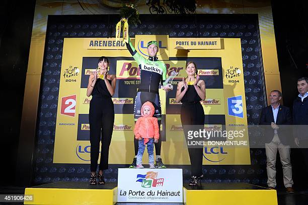 Stage winner Netherland's Lars Boom celebrates on the podium after winning the 1525 km fifth stage of the 101st edition of the Tour de France cycling...