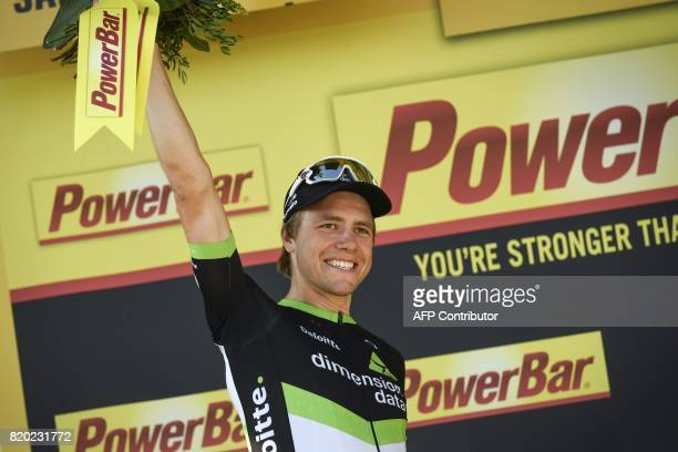 Stage winner Norway's Edvald Boasson Hagen celebrates on the podium after winning the 2225 km nineteenth stage of the 104th edition of the Tour de...