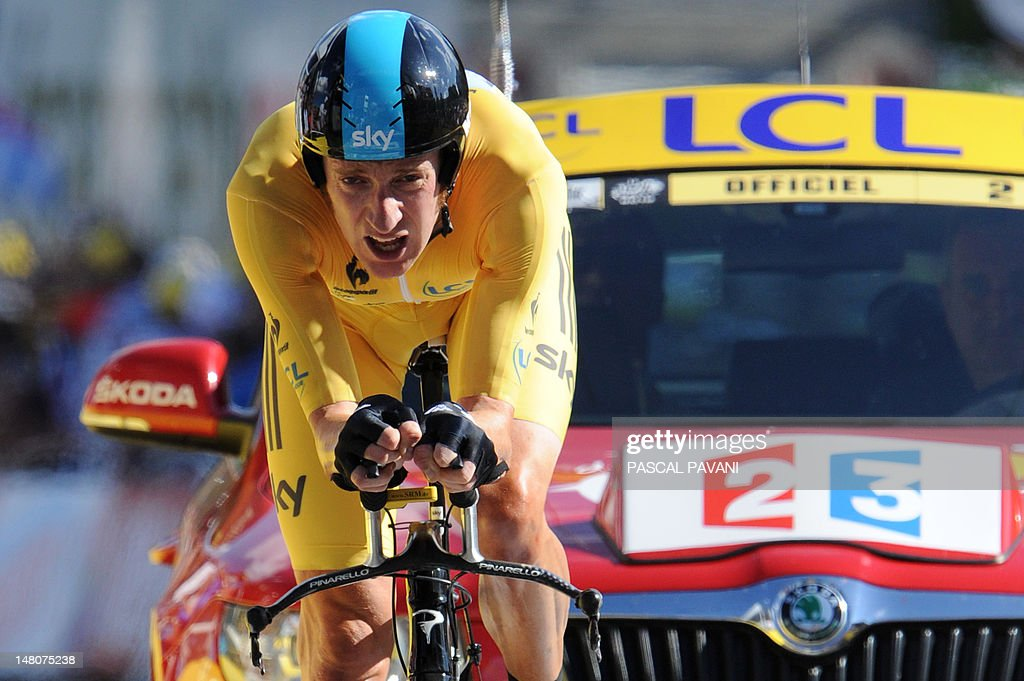 Stage winner, Overall leader's yellow jersey, British Bradley Wiggins, competes at the end of the 41,5 km individual time-trial and ninth stage of the 2012 Tour de France cycling race starting in Arc-et-Senans and finishing in Besancon, eastern France, on July 9, 2012.