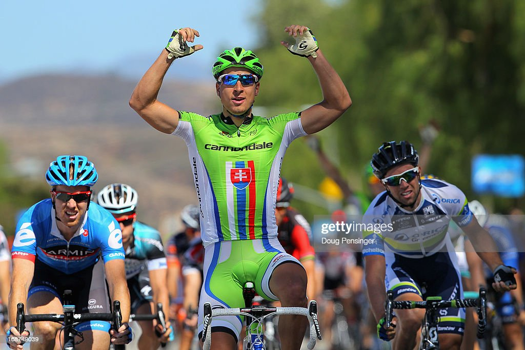 Stage winner <a gi-track='captionPersonalityLinkClicked' href=/galleries/search?phrase=Peter+Sagan&family=editorial&specificpeople=4846179 ng-click='$event.stopPropagation()'>Peter Sagan</a> of Slovakia riding for Cannondale Pro Cycling celebrates as he finishes ahead of Michael Matthews of Australia riding for Orica Green Edge in second place and <a gi-track='captionPersonalityLinkClicked' href=/galleries/search?phrase=Tyler+Farrar&family=editorial&specificpeople=705251 ng-click='$event.stopPropagation()'>Tyler Farrar</a> of the USA riding for Garmin-Sharp to win Stage Three of the 2013 Amgen Tour of California from Palmdale to Santa Clarita on May 14, 2013 in Santa Clarita, California.