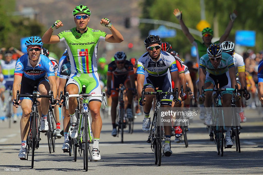 Stage winner Peter Sagan (2R) of Slovakia riding for Cannondale Pro Cycling celebrates as he finishes ahead of Michael Matthews (2L) of Australia riding for Orica Green Edge in second place and Tyler Farrar (L) of the USA riding for Garmin-Sharp in third place to win Stage Three of the 2013 Amgen Tour of California from Palmdale to Santa Clarita on May 14, 2013 in Santa Clarita, California.