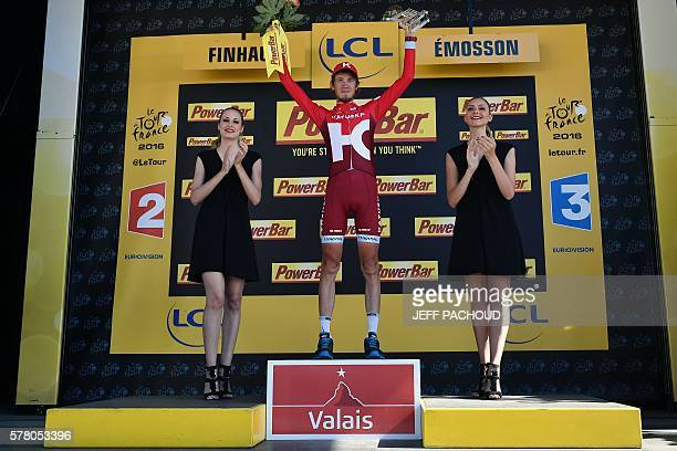 Stage winner Russia's Ilnur Zakarin celebrates on the podium after winning the 1845 km seventeenth stage of the 103rd edition of the Tour de France...