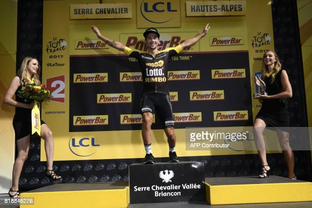 Stage winner Slovenia's Primoz Roglic celebrates on the podium after winning the 183 km seventeenth stage of the 104th edition of the Tour de France...