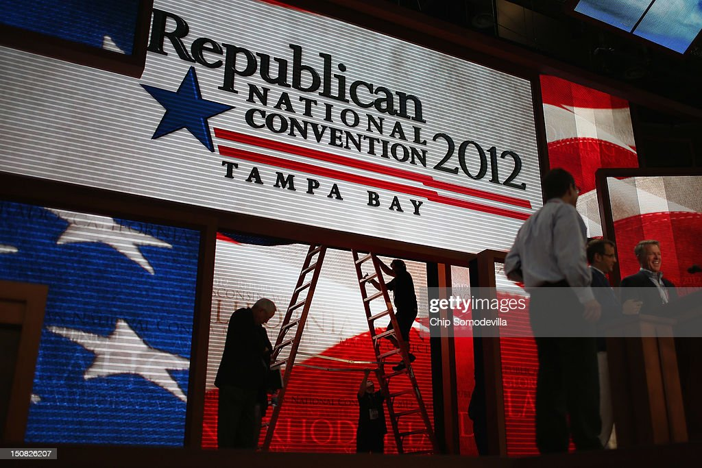 Stage workers continue to make last-minute adjustments to the main stage at the Tampa Bay Times Forum on the abbreviated first day of the Republican National Convention August 27, 2012 in Tampa, Florida. Organizers decided to delay the start of the convention as the projected path of Tropical Storm Isaac' put the storm blowing past Tampa and into the Gulf of Mexico.