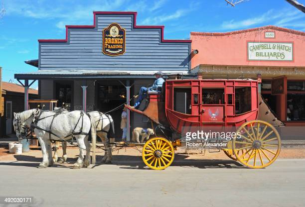 A stagecoach waits for riders to board for a horsedrawn tour of historic Tombstone Arizona known as 'The Town Too Tough to Die' The town featuring...