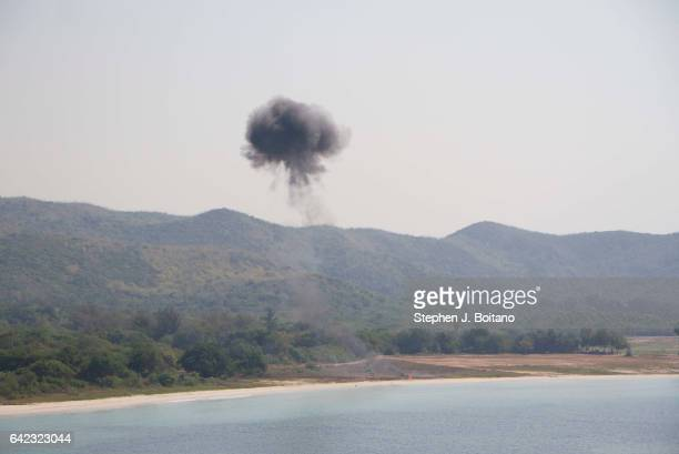 SATTAHIP CHONBURI THAILAND A staged explosion occurs on the beach head during the ongoing USThai joint military exercise titled 'Cobra Gold' on Hat...