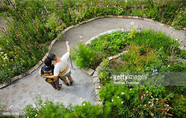 Staged photo A young couple is standing in front of a newly created path in their garden on August 12 2016 in Berlin Germany