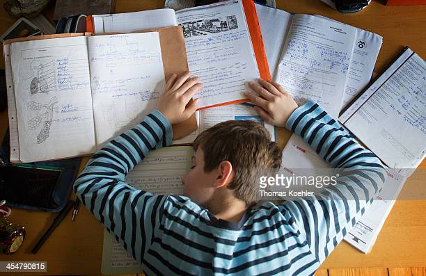 A staged photo of a boy having fallen asleep at his desk whilst doing homework as pictured on October 27 2013 in Berlin Germany