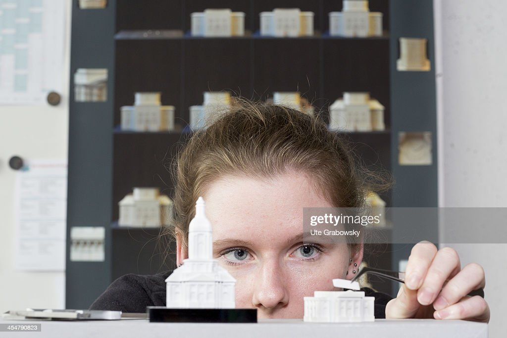 A staged photo of a trainee model maker working on the 3D plastic model of a church at the Beuth technical college on October 28, 2013 in Berlin, Germany.