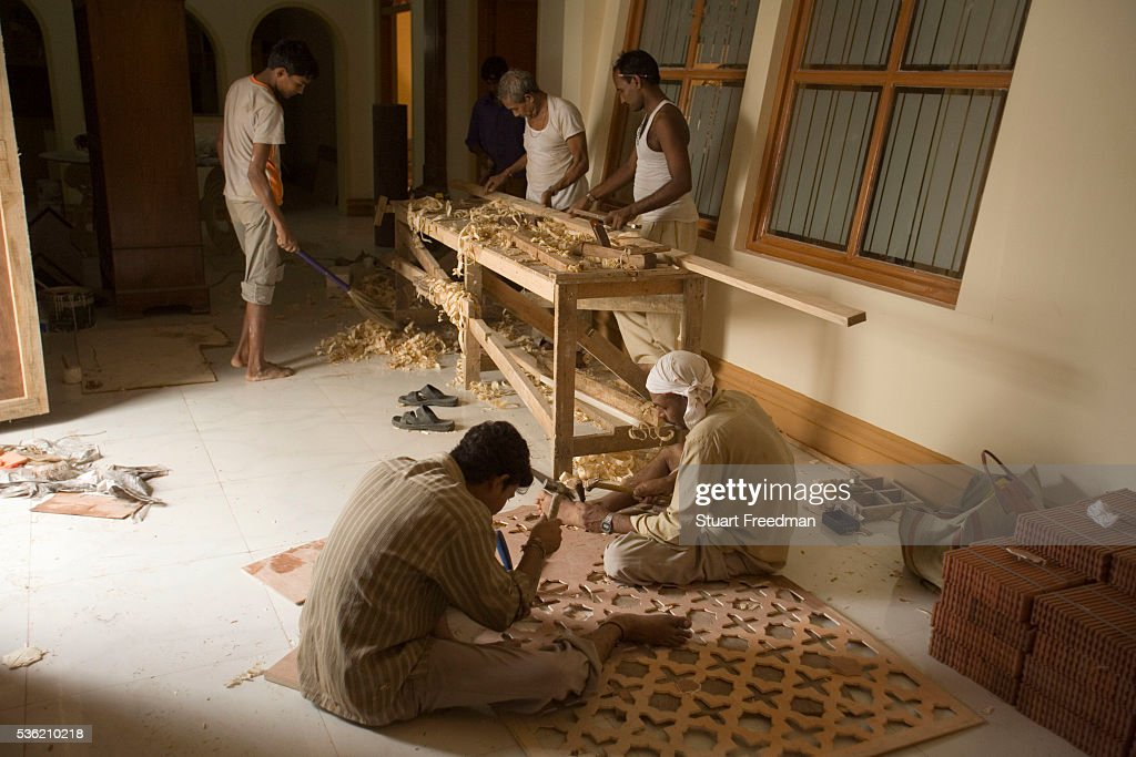 Stagehands paint and decorate a set in a studio of Mumbai India The Merchants of Bollywood an Indian theatrical dance musical charts the history of...