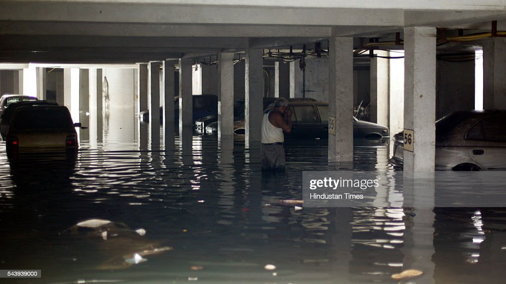 Stagnated water in the basement of Dheeraj Heritage Residency II, at Daulat Nagar, Santacruz (W) on July 30, 2005 in Mumbai, India. The road got damaged due to the flood water last week.