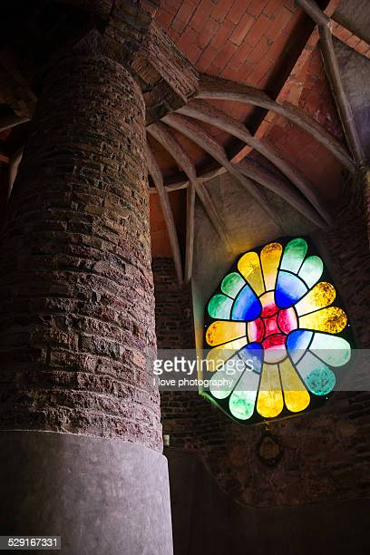 Stained glass and column in Gaudi's crypt