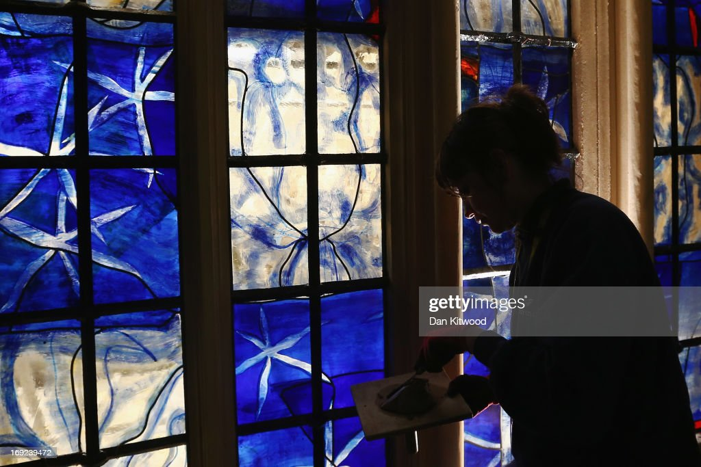 Stained glass artist Helen Whittaker of Barley Studio in York puts finishing touches to one of the new stained glass windows in the 'Lady Chapel' at Westminster Abbey on May 21, 2013 in London, England. The panels, each comprising of more than 50 individual, handmade pieces of glass, are the first to be commissioned by the Abbey for more than a decade. The Abbey has announced plans to unveil the two new stained glass windows, which were designed by British artist, Hughie O'Donoghue, in the Chapel to mark the 60th anniversary of the Coronation of HM The Queen which will take place in the Abbey on June 4, 2013.