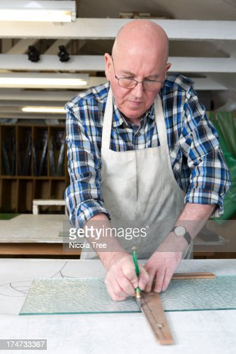 Stained glass craftsman cutting glass design : Stock Photo