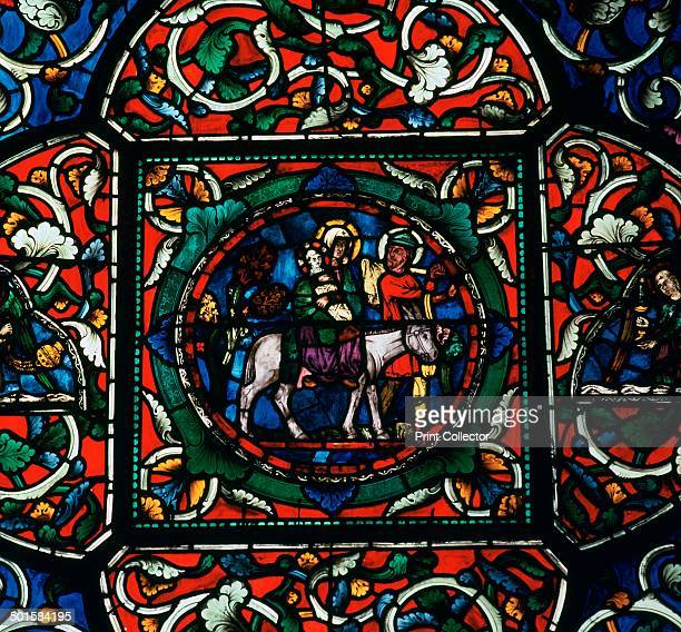 Stained glass depiction of the holy family fleeing to Egypt in the South Choir Aisle of Canterbury Cathedral 12th century