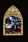 Stained glass window of Jesus praying in the Garden of Gethsemane found in a century old church.