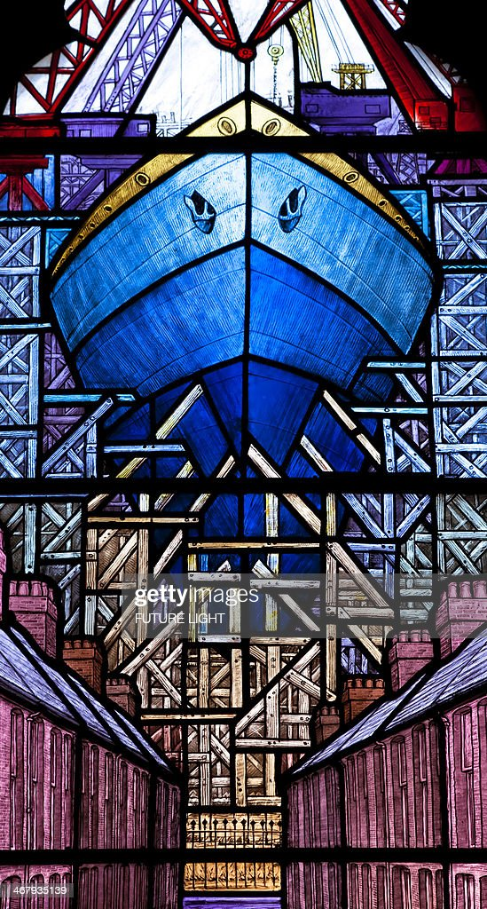 Stained glass of ship being built : Stock Photo