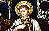 Stained glass portrait of boy holding crucifix