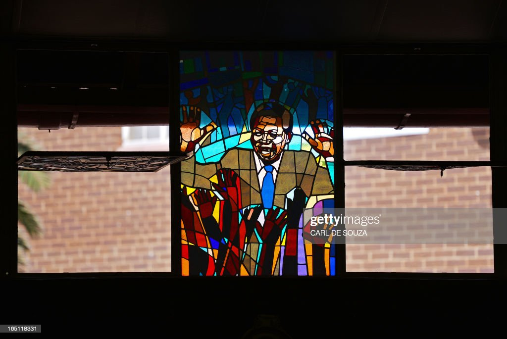 A stained glass window depicting former South African president Nelson Mandela is pictured at Regina Mundi church in Soweto on March 31, 2013. Regina Mundi church is situated near Mandela's old residence and is known for its involvement during the struggle against apartheid. Mandela is spending his fourth day in hospital after making 'steady progress' for a recurring lung infection. The 94 year old is idolised in his home nation. It is the second time within a month that he has been admitted to hospital, after spending a night for check-ups on March 9, 2013. AFP PHOTO/Carl de Souza