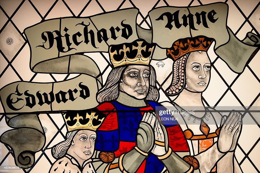 A stained glass window depicting King Richard III and his wife and son is displayed in the new visitor's centre on the site where his remains were discovered, in Leicester, central England, on July 24, 2014. The centre tells the story of his rise to power, his death in battle and the discovery of his bones, as well as raising questions on how his disability should be portrayed in theatre and film. Exhibits include a remarkably detailed facial reconstruction, and a replica of Richards skeleton that clearly shows his curved spine, as well as his battle injuries, including the fatal blow. Opening on July 26, 2014, the centre hopes to attract up to 100,000 visitors in it's first year. AFP PHOTO/Leon Neal