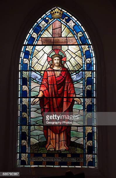 Stained glass window picture of the risen Christ parish church of Saint Lawrence Knodishall Suffolk England