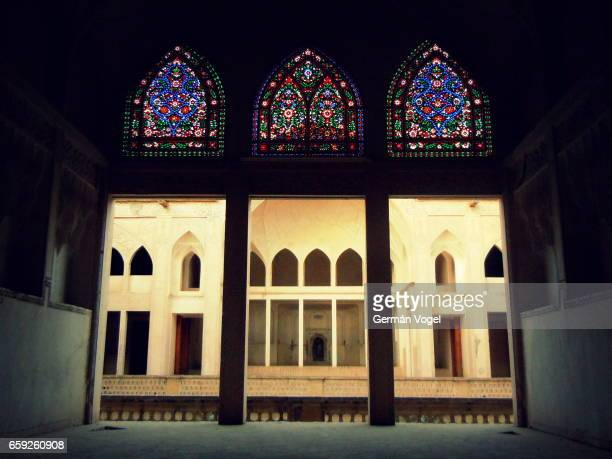 Stained glass windows and arches of Silk Road palace - Kashan, Iran